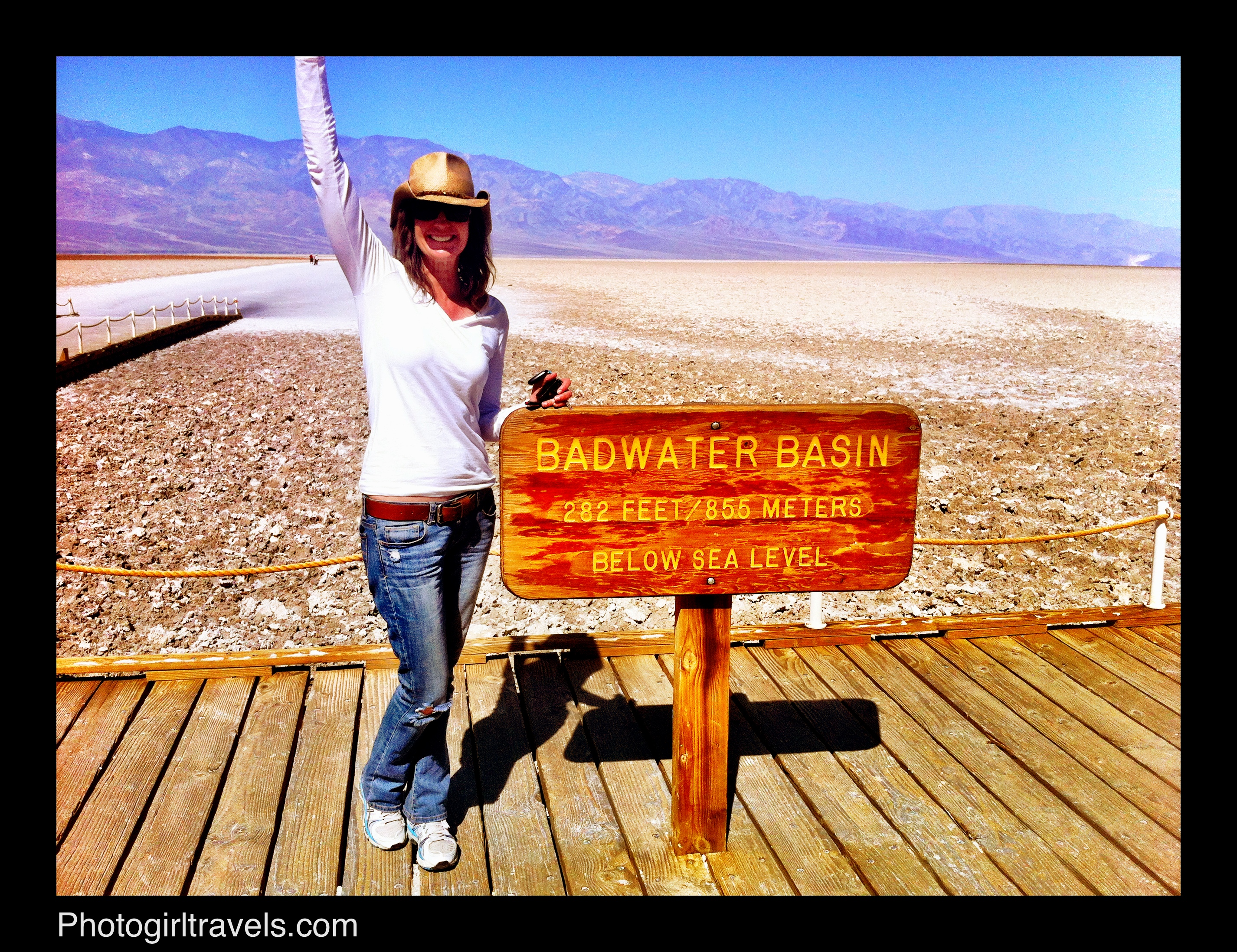 Me standing by Badwater sign in Death Valley - don't forget a hat!