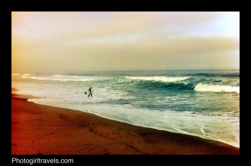 Surfer entering the water by teh Manhattan Beach Pier